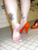 April washes her feet in the ladys room