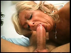 busty-blonde-mature-whore-gives-nice-head-to-her-younger