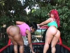 big-ass-ebony-duo-performing-a-nasty-car-wash-outdoor