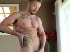 muscular-tattooed-jock-pulling-his-cock