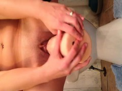 toying-with-huge-dildo-on-toilet-sink