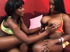 lesbo ebony flaunting huge boobs and huge ass