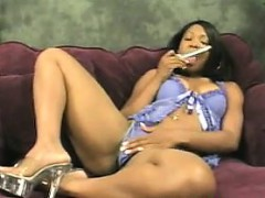 ebony-woman-vibrates-her-pussy-with-a-toy