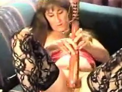 mature-whore-masturbates-with-a-club