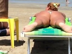 Thick White Woman Tanning At The Beach