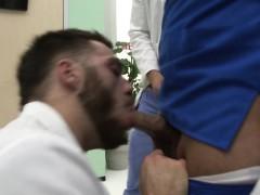 Muscular Stud Sucking Two Big Dicks