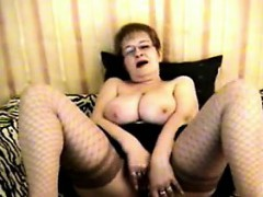 busty-granny-being-kinky-in-fishnets