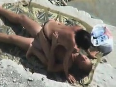 couple-having-sex-outdoors-at-the-beach