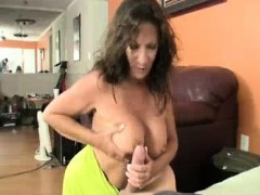 his thick cock turns the horny milf on Handjob