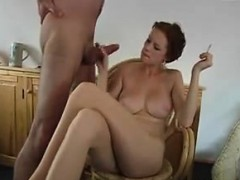 slut-stroking-cock-and-smoking-a-cigarette