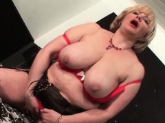 sexy-mature-flashing-her-shaved-pussy-and-tits