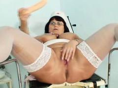 huge-tits-mother-nurse-shows-off-her-huge-mellons