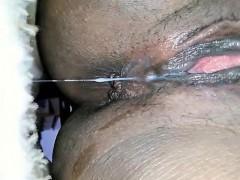 Black babe masturbates and squirts - closeup