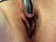 rubbing-her-pussy-lips-with-a-vibrator