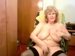 big titted granny masturbates on a cam show