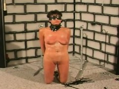 perv-applies-breast-torture-on-a-busty-brunette-slave