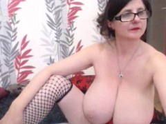 mature-with-big-tits-getting-naked