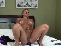 stacked and lustful asian milf ava devine drills her holes on the bed