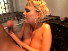 Short Haired Babe With Big Tits Works Her Lips And Her Feet On A Cock