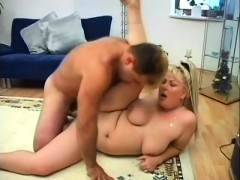 chubby blonde cocksucker gets her plump twat banged on the floor