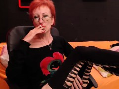 Hot Redhead Lady With Glasses Enjoys A Cigarette And Loses