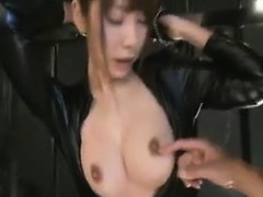 Submissive Oriental Babe In A Black Latex Outfit Exposes He