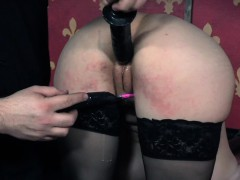 cuffed-slave-clit-stimulated-while-restrained