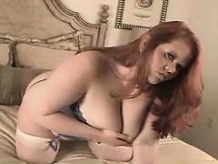 huge-redhead-gal-in-a-corset-mora