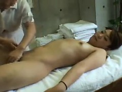 alluring-babe-has-a-masseuse-giving-her-peach-the-attention