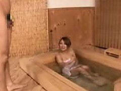 attractive-asian-bimbo-enjoys-taking-a-bath-dressed-only-in