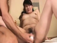 big titted oriental milf has a dildo and dick driving her pussy