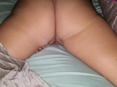 wife on bed masturbating