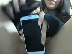 brunette-teen-shows-her-smartphone-and-pussy