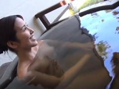 subtitled-japanese-mature-tae-bathes-in-outdoor-onsen