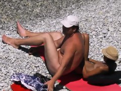 wife giving handjob on candid beach