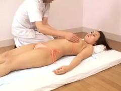 hot-asian-babe-puts-on-a-string-bikini-to-get-a-sensual-mas