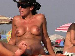 nudist on the beach with massive boobs is taking a shower Hot