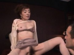 beautiful older playgirl jerks off a hard dick on her tits