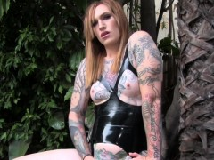 inked-transsexual-in-latex-masturbating