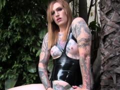 Inked Transsexual In Latex Masturbating