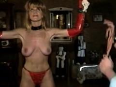 bdsm slave has got huge boobs