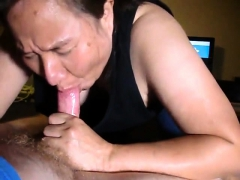 Close Up With Asian Maiden Giving Blowjob