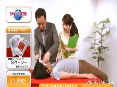 asian-girl-shows-the-use-of-condoms