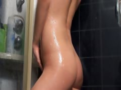 girlfriend-soaping-up-her-body-in-shower