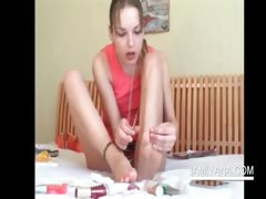 teenage-minx-ivana-painting-her-toe-nails-in-red