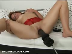 brunette-is-plowed-by-a-brutal-dildo-machine