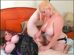 lesbian-bbw-duo-fucking-a-strap-on-in-bed