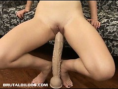 armani stretches her wet vagina out with a big dildo