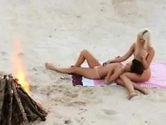 lesbian-babes-loving-each-other-at-a-beach