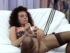 mature-woman-in-lingerie-using-a-vibrator